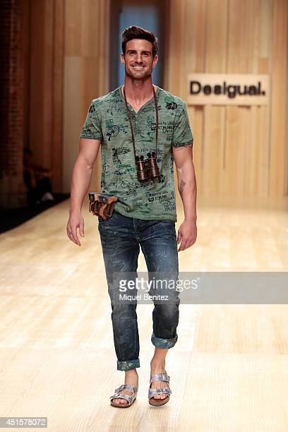 Aitor Ocio walks the runway during the Desigual show as part of the 080 Barcelona Fashion Spring/Summer 2015 on July 1 2014 in Barcelona Spain