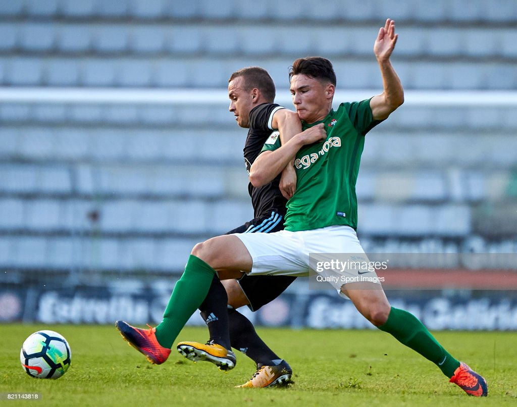 Aitor Pascual (R) of Racing de Ferrol competes for the ball with Stanislav Lobotka of Celta de Vigo during the pre-season friendly match between Celta de Vigo and Racing de Ferrol at A Malata Stadium on July 22, 2017 in Ferrol, Spain.