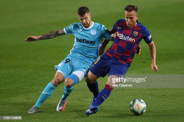 Aitor Ruibal of Leganes battles for possession with Arthur Melo of Barcelona during the Liga match between FC Barcelona and CD Leganes at Camp Nou on...