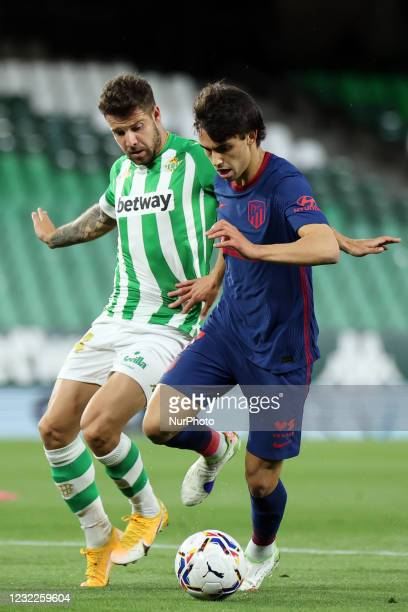 Aitor Ruibal of Real Betis Balompie in action with Joao Felix of Atletico de Madrid during the La Liga Santander match between Real Betis and...