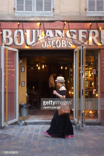 aix-en-provence, france: chic woman, old-fashioned bakery - aix en provence stock pictures, royalty-free photos & images