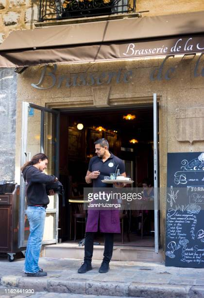 aix-en-provence, france: customer pays waiter outside brasserie - aix en provence stock pictures, royalty-free photos & images
