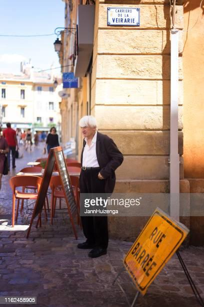 aix-en-provence, france: senior man stands on street corner - aix en provence stock pictures, royalty-free photos & images