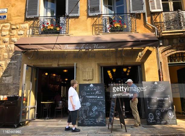 aix-en-provence, france: tourist couple outside brasserie - aix en provence stock pictures, royalty-free photos & images