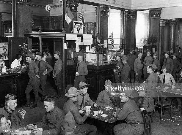 Interior of the casino now used by the YMCA showing the old bar in LaSalle de Bacchus YMCA girls are serving refreshments to the boys Photograph...