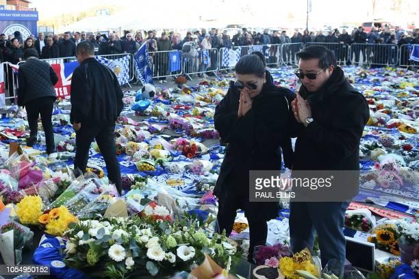 TOPSHOT Aiyawatt Srivaddhanaprabha and Aimon Srivaddhanaprabha the son and wife of Leicester City's Thai chairman Vichai Srivaddhanaprabha who died...