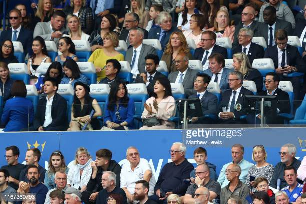 Aiyawatt Srivaddhanaprabha Chairman of Leicester City Football Club and his family are seen in the stands during the Premier League match between...