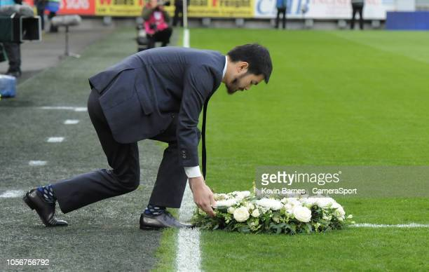 Aiyawatt Srivaddhanaprabha lays a wreath in memory of his father Vichai Srivaddhanaprabha during the Premier League match between Cardiff City and...