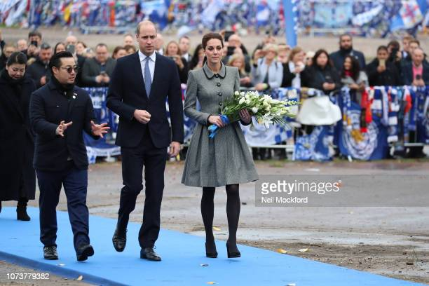 Aiyawatt Srivaddhanaprabha Prince William Duke of Cambridge and Catherine Duchess of Cambridge pay tribute to those who were tragically killed in the...
