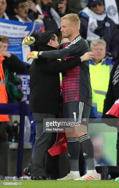 Aiyawatt Srivaddhanaprabha son of Leicester City chairman Vichai Srivaddhanaprabha embraces Kasper Schmeichel of Leicester City after the Premier...