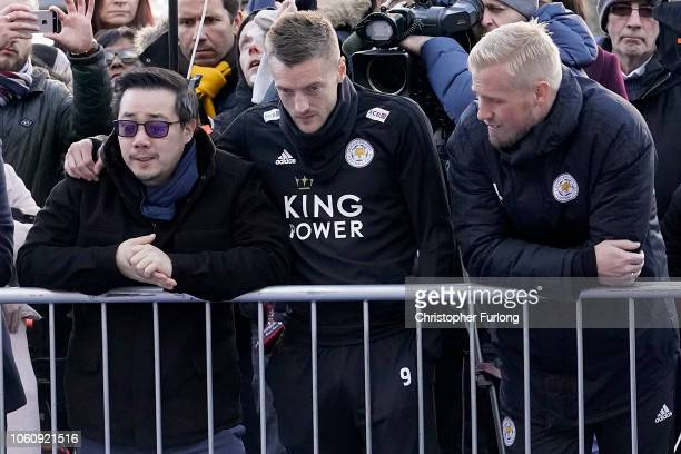 Aiyawatt Srivaddhanaprabha son of the late Leicester City owner Vichai Srivaddhanaprabha stands with Jamie Vardy and Kasper Schmeichel as they pay...