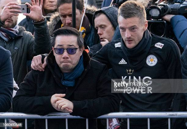 Aiyawatt Srivaddhanaprabha son of the late Leicester City owner Vichai Srivaddhanaprabha stands with Jamie Vardy as they pay their respects at the...