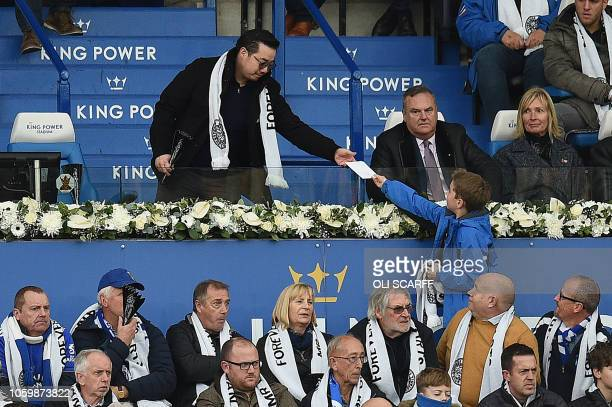 Aiyawatt Srivaddhanaprabha the son of Leicester City's Thai chairman Vichai Srivaddhanaprabha takes an envelope from a boy during the English Premier...