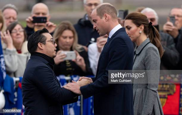 Aiyawatt 'Top' Srivaddhanaprabha with Prince William Duke of Cambridge and Catherine Duchess of Cambridge pay tribute to those who were tragically...