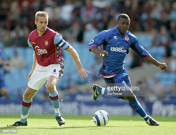 Aiyegbeni Yakubu beats Olof Mellberg to the ball during the Barclays Premiership match between Aston Villa and Middlesbrough at Villa Park on October...