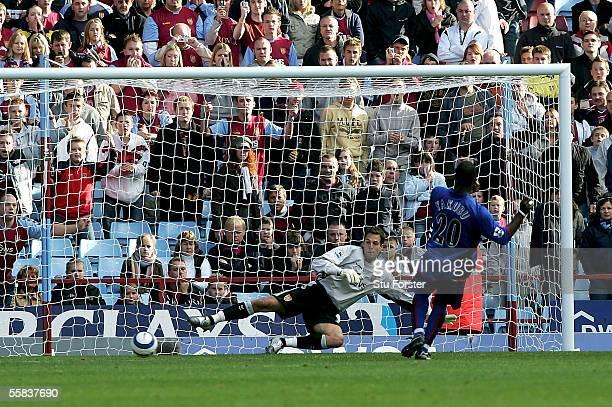 Aiyegbeni Yakubu beats Villa keeper Thomas Sorensen to score the third Boro goal during the Barclays Premiership match between Aston Villa and...