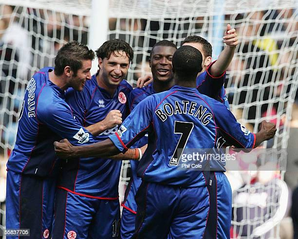 Aiyegbeni Yakubu of Middlesbrough scores from the Penalty and gets congratulated by Fabio Rochemback during the Barclays Premiership match between...