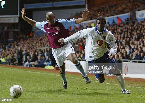 Aiyegbeni Yakubu of Portsmouth is challenged by Dion Dublin of Aston Villa during the FA Barclaycard Premiership match between Aston Villa and...