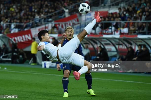 Aizar Akmatov of Kyrgyz Republic competes for the ball during the international friendly match bewteen Japan and Kyrgyz at Toyota Stadium on November...