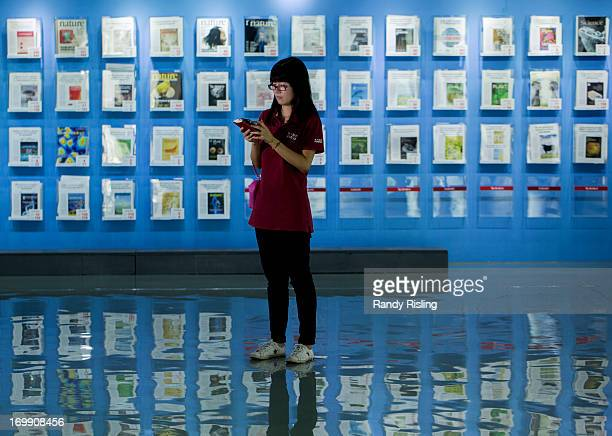 CHINA Aizhu Wang communications official at Beijing Genomics Institute in front of a wall of Nature Journals BGI is the fourth largest contributor to...