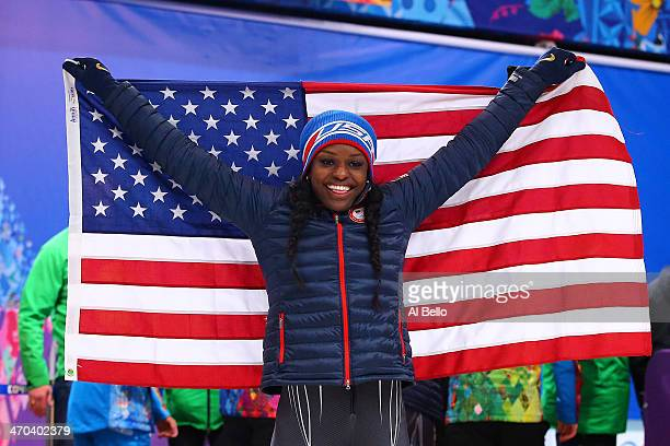 Aja Evans of the United States team 2 celebrates after winning the bronze medal during the Women's Bobsleigh on Day 12 of the Sochi 2014 Winter...