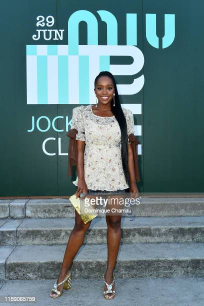 Aja Naomi King attends Miu Miu Club event at Hippodrome d'Auteuil on June 29 2019 in Paris France