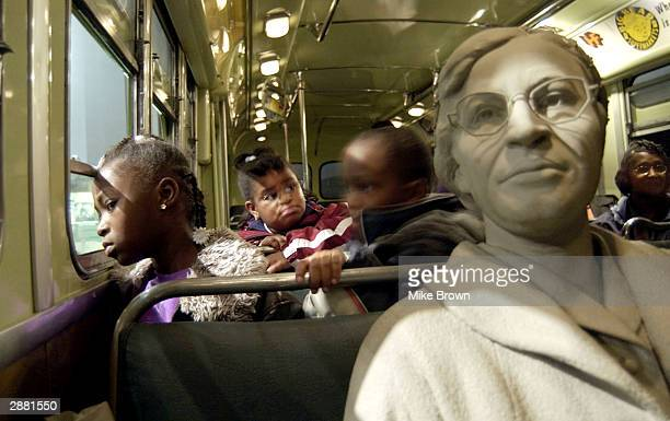 Aja Robertson looks out the window of the Rosa Parks bus exhibit at the National Civil Rights Museum January 19 2004 in Memphis Tennessee The...