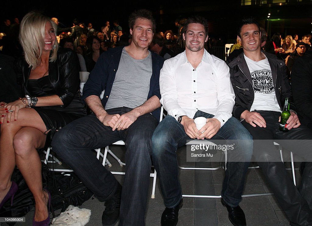Aja Rock (L) looks on at All Blacks Ali Williams, Richie McCaw and Daniel Carter are seen in the front row during the Huffer show as part of New Zealand Fashion Week 2010 on September 24, 2010 at Owen Glenn Building in Auckland, New Zealand.