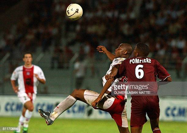 Ajaccio forward Waldir Lucas vies with Metz defender Bruno Pompiere during their French L1 football match 14 August 2004 at the Francois Coty stadium...