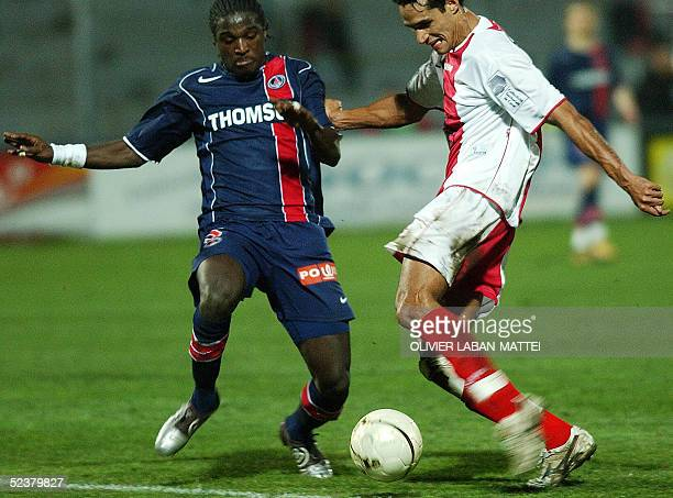 Ajaccio's Brazilian midfielder Andre Luiz vies with Paris's French defender Bernard Mendy during their French L1 football match 12 March 2005 at the...