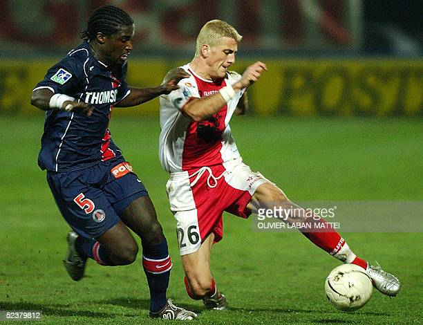 Ajaccio's midfielder Yohan Demont vies with Paris's defender Bernard Mendy during their French L1 football match 12 March 2005 at the Francois Coty...