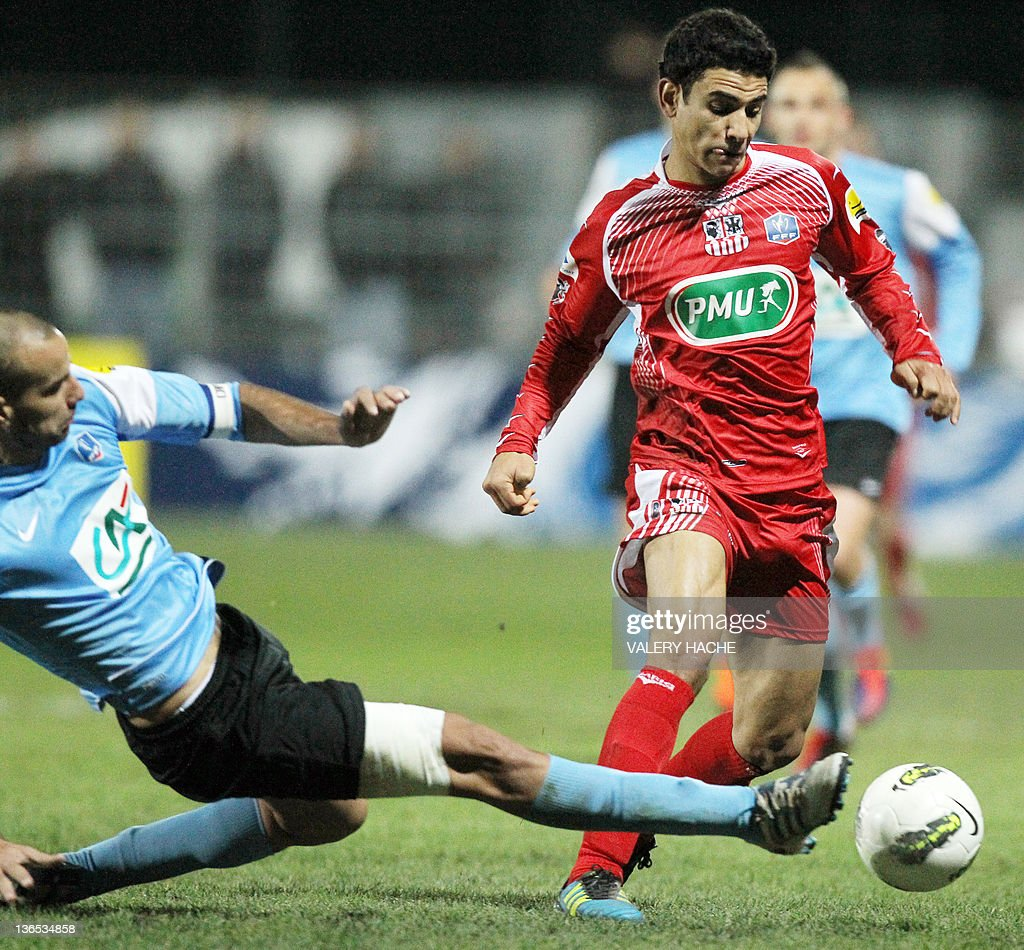 Ajaccio's Andre Benjamin (R) vies with Frejus's Vincent Fernandez (L) during the French Cup football match Frejus (NAT) vs Ajaccio (L1), on January 07, 2012 at Frejus.