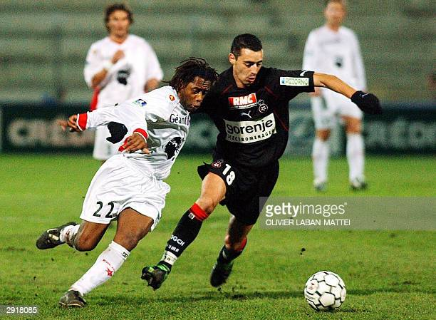 Ajaccio's forward Bernard Diomede tries to dribble past Nice's midfielder Olivier Echouafni during their French L1 soccer match 31 January 2004 at...
