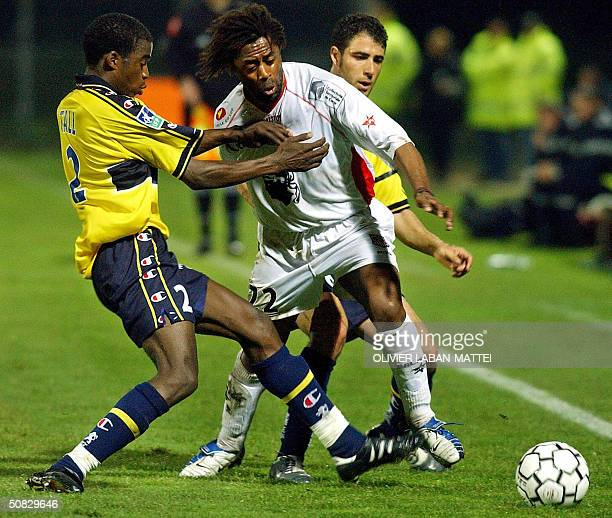 Ajaccio's forward Bernard Diomede vies with Sochaux's defender Ibrahim Tall and Argentinian midfielder Marcelo Trapasso during their French L1...