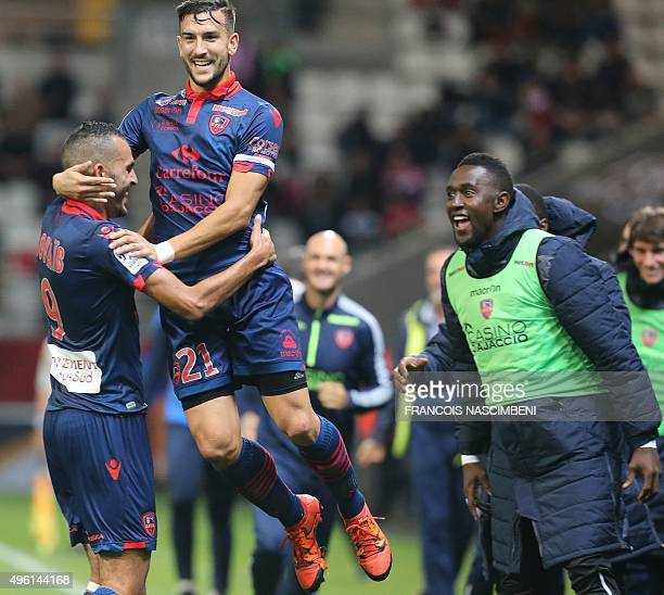 Ajaccio's French defender Pablo Martinez congratulates his teammate French forward Khalid Boutaid after he scored a goal during the French L1...
