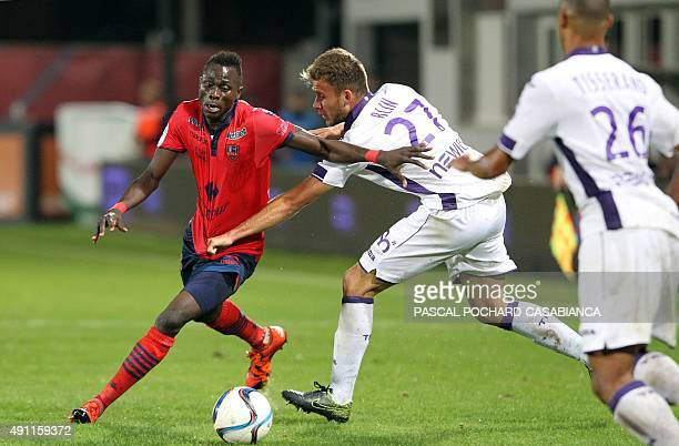 Ajaccio's French forward Kevin Mayi vies with Toulouse's French midfielder Alexis Blin during the French L1 football match GFC Ajaccio against...