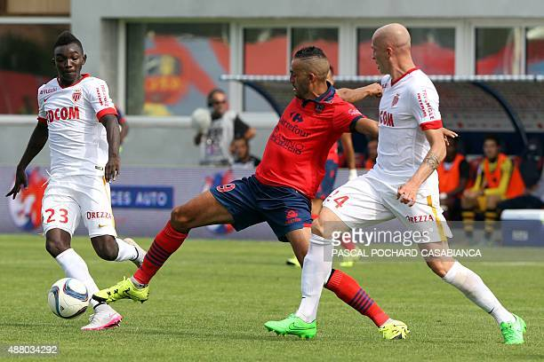 GFC Ajaccio's French forward Khalid Boutaid vies with Monaco's Italian defender Andrea Raggi during the French L1 football match between GFC Ajaccio...