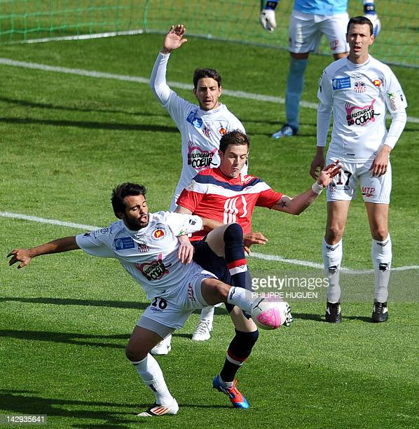 Ajaccio's French midfielder Johan Cavalli vies with Lille's French forward Nolan Roux during the French L1 football match Lille vs Ajaccio on April...