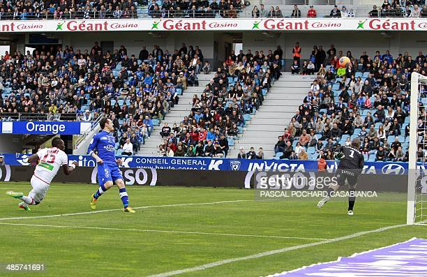 Ajaccio's Guinean forward Aboudacar Camara scores a goal past Bastia's French goalkeeper Mickael Landreau during the French L1 football match between...