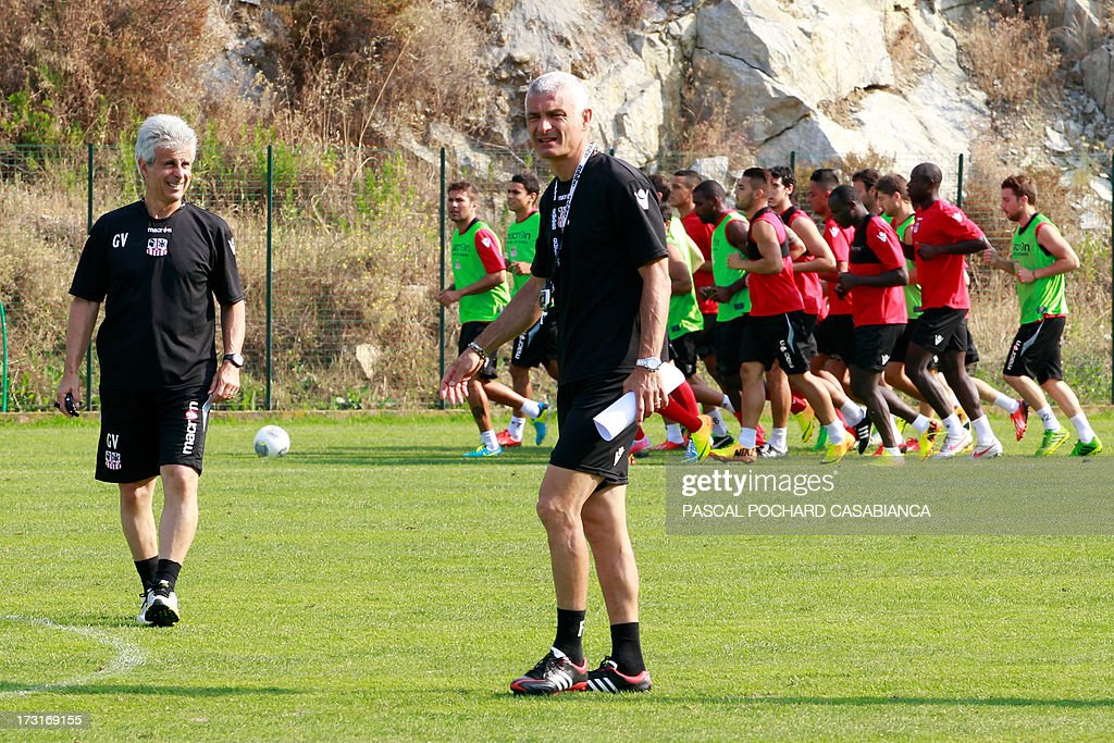 Ajaccio's L1 football club head coach, Italy's Fabrizio Ravanelli (C) and assistant coach Giampiero Ventrone (L) attend a training session on July 9, 2013 in Ajaccio, French Mediterranean island of Corsica.