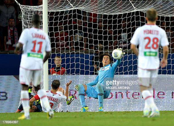 Ajaccio's Mexican goalkeeper Guillermo Ochoa aka Memo stops the ball during the French L1 football match between Paris SaintGermain and Ajaccio on...