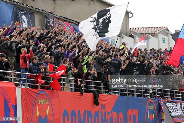 Ajaccio's supporters cheer prior to the L1 football match Gazelec Ajaccio VS Bastia on April 24 2016 at the AngeCasanova stadium in Ajaccio on the...