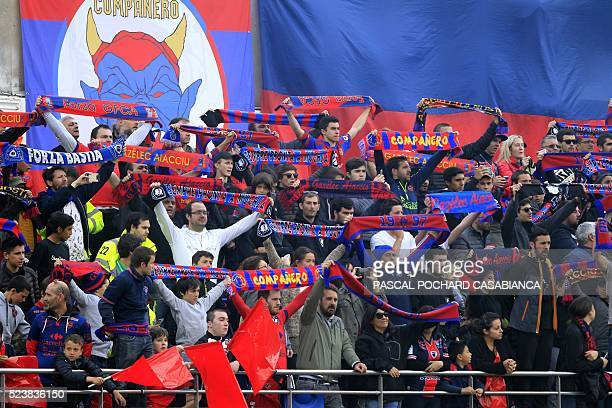 Ajaccio's supporters cheer their team before the French L1 football match Gazelec Ajaccio against Bastia on April 24 at the Ange Casanova stadium in...