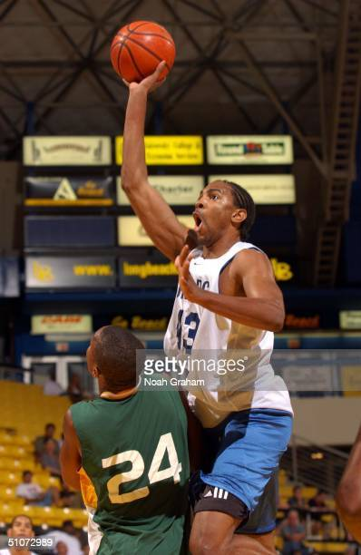 Ajani Williams of the Dallas Mavericks takes the ball to the hoop during the NBA Summer League at the Pyramid of the University of California Long...