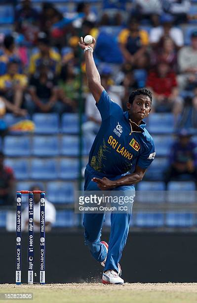 Ajantha Mendis of Sri Lanka bowls during the C1 versus D2 Super Eight match between Sri Lanka and New Zealand at Pallekele Cricket Stadium on...