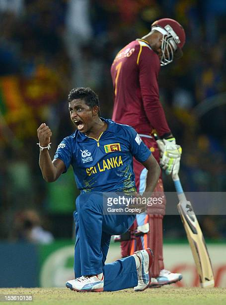 Ajantha Mendis of Sri Lanka celebrates dismissing Andre Russell of the West Indies during the ICC World Twenty20 2012 Final between Sri Lanka and the...