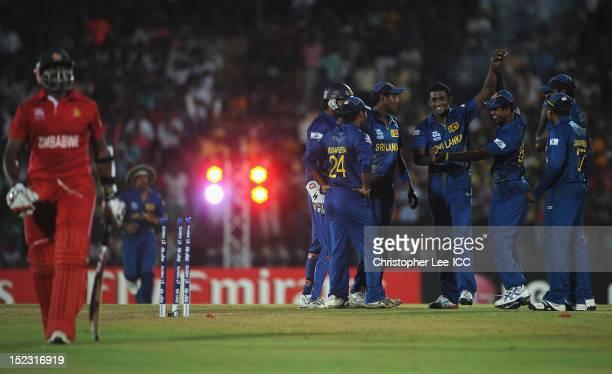 Ajantha Mendis of Sri Lanka celebrates taking the wicket of Hamilton Masakadza of Zimbabwe during the ICC World Twenty20 Cup Group C match between...