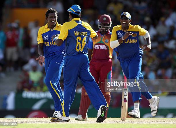 Ajantha Mendis of Sri Lanka celebrates the wicket of Ramnaresh Sarwan of West Indies during the ICC World Twenty20 Super Eight match between West...