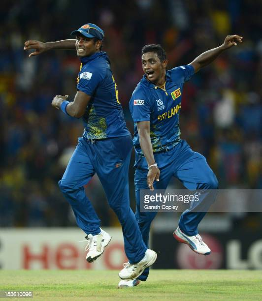 Ajantha Mendis of Sri Lanka celebrates with Lahiru Thirimanne after dismissing Kieron Pollard of the West Indies during the ICC World Twenty20 2012...
