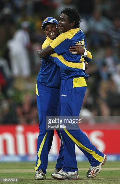 Ajantha Mendis of Sri Lanka celebrates with team mate Thilan Samaraweera after taking the wicket of Jacques Kallis of South Africa during the ICC...